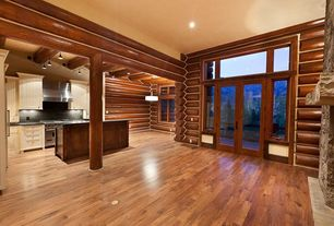 Rustic Great Room with Exposed beam, can lights, Standard height, French doors, Transom window, Hardwood floors, Columns