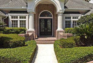 Traditional Front Door with exterior stone floors, Pathway, Glass panel door, Transom window, exterior brick floors