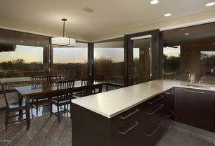 Contemporary Dining Room with Pendant light, simple granite floors, French doors