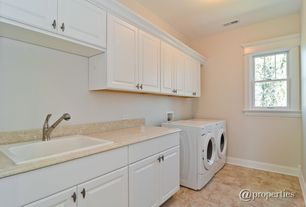 Modern Laundry Room with Undermount sink, terracotta tile floors