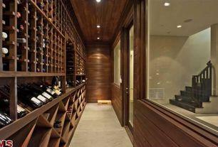 Contemporary Wine Cellar with Concrete floors, Designer series 60-bottle 6-column half height wine rack, French doors