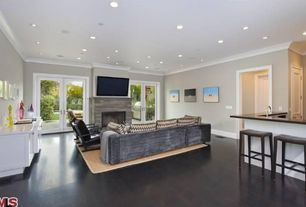 Traditional Great Room with Crown molding, Cement fireplace, French doors, Hardwood floors