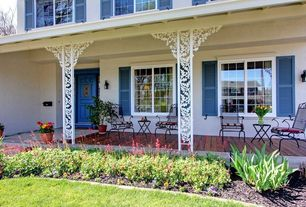 Country Porch with six panel door, exterior stone floors, Wrap around porch, Casement