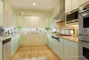 Contemporary Kitchen with U-shaped, Flat panel cabinets, Hardwood floors, Wall Hood, electric cooktop, Standard height
