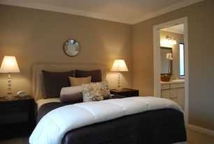 Contemporary Guest Bedroom with Wall sconce, Crown molding, Design Craft Coeus Silver Plate Wall Mirror, Laminate floors