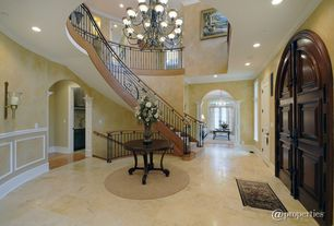 Traditional Entryway with Wainscotting, Chandelier, travertine floors, Wall sconce, Chair rail, High ceiling