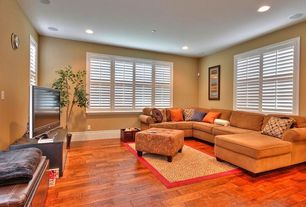 Modern Living Room with can lights, Carpet, Hardwood floors, Standard height, Casement