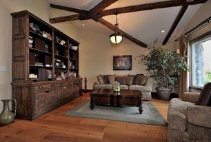 Craftsman Living Room with picture window, Standard height, can lights, flush light, Exposed beam, Hardwood floors