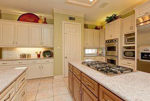 Traditional Kitchen with Kitchen island, specialty tile floors, full backsplash, U-shaped, Large Ceramic Tile, Crown molding