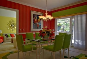 Eclectic Dining Room with Deep red stripe wallpaper, Chandelier, Cosmic raindrops mirror, Crown molding, Area rug, Carpet