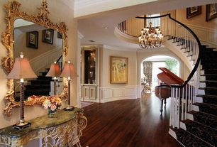 Traditional Hallway with Wainscotting, Hardwood floors, Crown molding, Chandelier
