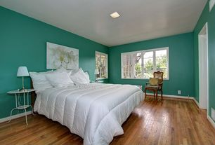 Modern Guest Bedroom with Hardwood floors, LINDVED Side table, ARSTID Table lamp