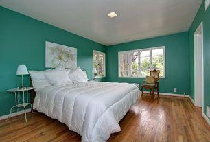 Modern Guest Bedroom with can lights, Standard height, Casement, Hardwood floors