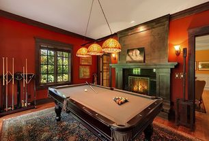 Traditional Game Room with Fireplace, French doors, metal fireplace, Pendant light, Casement, Standard height, Wall sconce