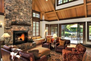 Craftsman Living Room with stone fireplace, French doors, Hardwood floors, Exposed beam, Window seat, Cathedral ceiling