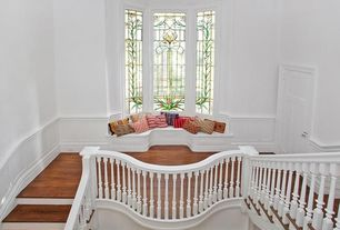Traditional Staircase with curved staircase, Crown molding, specialty window, Bamboo floors, Wainscotting, Window seat