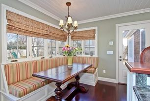 Cottage Dining Room with Belcaro walnut finish 3-light mini chandelier, Glass panel door, Chandelier, Crown molding