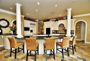 Traditional Kitchen with Undermount sink, Crown molding, Pottery barn seagrass chair, Arched doorway, Breakfast bar, Columns
