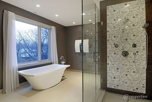"Eclectic Master Bathroom with frameless showerdoor, 67"" Albrighton Acrylic Tub, Handheld showerhead, Concrete floors"