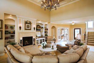 Mediterranean Living Room with Box ceiling, Standard height, Built-in bookshelf, Chandelier, flush light, Casement, Fireplace