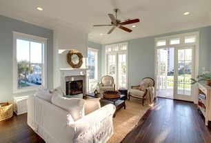 Traditional Living Room with Hardwood floors, French doors, Chandra zola tan jute area rug, Ceiling fan, Crown molding