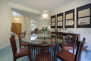 Eclectic Dining Room with Chandelier, Carpet, Transom window, Pendant light