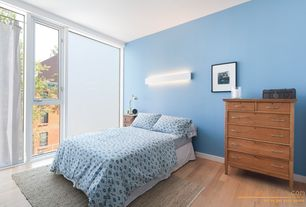 Modern Guest Bedroom with flush light, Hardwood floors