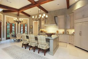Traditional Kitchen with Undermount sink, Penny Tile, Chandelier, Kitchen island, Breakfast bar, Complex marble counters