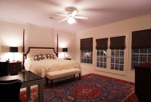 Traditional Guest Bedroom with French doors, Ceiling fan, flush light, Carpet, Crown molding