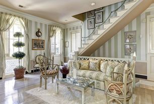 Traditional Living Room with interior wallpaper, can lights, Casement, Chair rail, Crown molding, Laminate floors