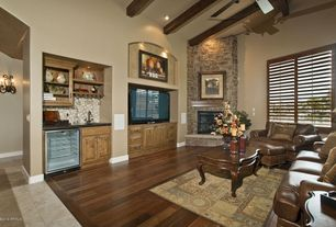 Craftsman Living Room with High ceiling, Fireplace, Columns, can lights, Wall sconce, stone fireplace, Carpet, Exposed beam