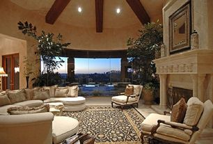 Traditional Living Room with Cement fireplace, Fireplace, Curved sectional sofa, Paint 1, Carpet, Area rug, picture window
