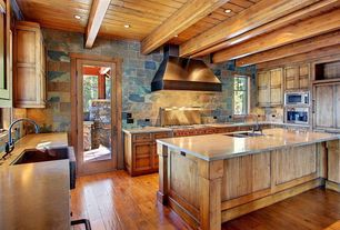 Craftsman Kitchen with Farmhouse sink, L-shaped, Slate Tile, Flat panel cabinets, Concrete counters, Custom hood, Stone Tile