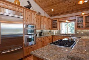 Rustic Kitchen with dishwasher, Hardwood floors, can lights, under cabinet lights, Framed Partial Panel, Undermount sink
