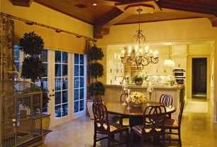Traditional Dining Room with French doors, Chandelier, Exposed beam