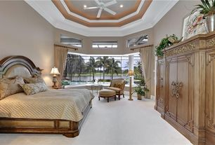 Traditional Master Bedroom with Crown molding, Ceiling fan, Carpet, Window seat, High ceiling