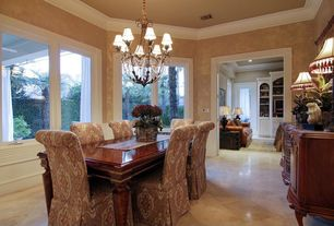 Traditional Dining Room with Wainscotting, Carpet, Crown molding, Chandelier