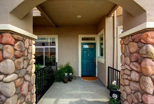 Traditional Porch with Transom window, Deck Railing, Casement, exterior stone floors, six panel door, Wrap around porch