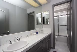 Contemporary 3/4 Bathroom with simple granite tile counters, Powder room, specialty door, Raised panel, Frameless, Stone Tile