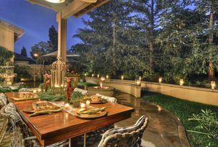 Mediterranean Patio with Fire pit, exterior stone floors, Raised beds, Fountain