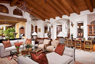 Eclectic Great Room with Chandelier, Exposed beam, High ceiling, Carpet, Arched window