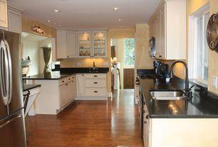 Modern Kitchen with U-shaped, Raised panel, Soapstone counters, Soapstone, Glass panel, Hardwood floors, Undermount sink