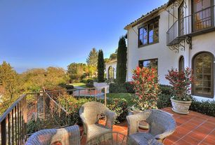 Eclectic Patio with Gate, Pathway, exterior terracotta tile floors, exterior tile floors, Arched window