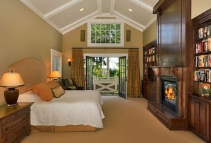 Craftsman Guest Bedroom with Carpet, metal fireplace, Wall sconce, French doors, Fireplace, Crown molding, High ceiling
