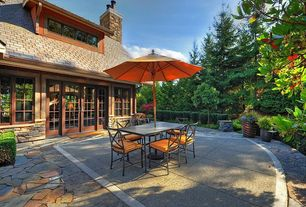 Craftsman Patio with French doors, Skylight, exterior stone floors