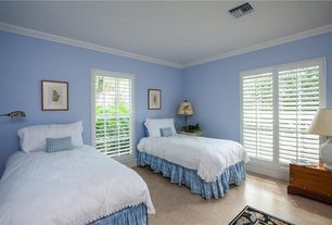 Traditional Guest Bedroom with Crown molding, Concrete floors