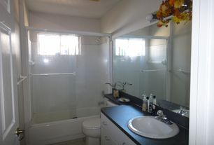 Traditional Full Bathroom with specialty door, Simple granite counters, tiled wall showerbath, Simple Granite, Flush