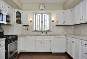 Traditional Kitchen with Calacatta gold honed marble, flush light, Hardwood floors, Complex Marble, Raised panel cabinets