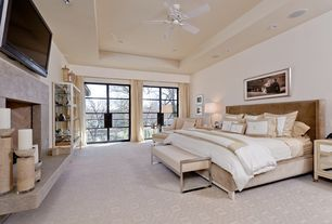 Modern Master Bedroom with French doors, Carpet, Pental sahara gold polished marble, Cement fireplace
