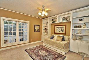 Traditional Guest Bedroom with Carpet, flush light, double-hung window, Crown molding, Ceiling fan, Standard height